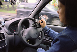 Young woman with cerebral palsy driving specially adapted car for the disabled,