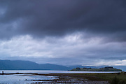 Heavy cloud over tranquil Scottish landscape, Argyllshire coast, Western Scotland