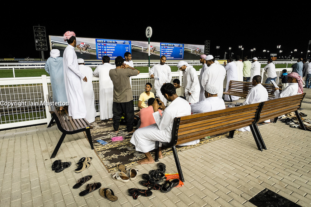 horse racing meeting at Al Meydan racecourse at night in Dubai United Arab Emirates