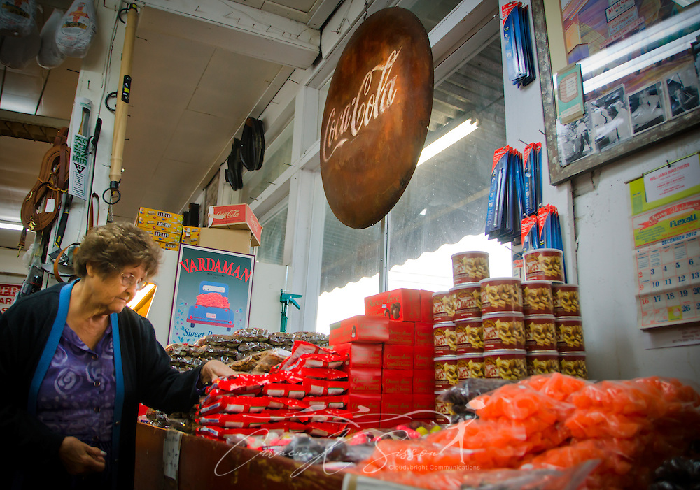 Virginia Pettie, of Attala, looks at packages of Georgia pecans at Williams Brothers General Store in Philadelphia, Miss. Dec. 11, 2012. The store carries a number of hard-to-find items like old-fashioned candies and locally-grown produce. (Photo by Carmen K. Sisson/Cloudybright)