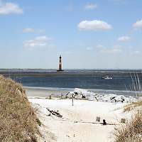 Folly Island beach with lighthouse in the distance, Charleston, SC, USA.