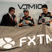 Sky Sport F1's David Croft (left) asks Force India drivers Sergio Perez (middle) and Esteban Ocon (right) a few questions before the new car is revealed. Force India launch their 2017 Formula One car at a press event held in the Silverstone WIng.  Live-streamed via Sky Sports F!, Sky commentators hosted the event.