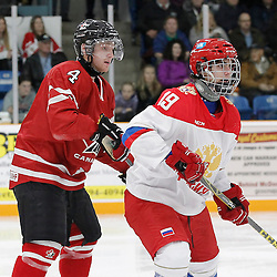 TRENTON, - Dec 10, 2015 -  Exhibition Game 3-  Russia vs Team Canada West at the 2015 World Junior A Challenge at the Duncan Memorial Gardens, ON. Brett Orr #4 of Team Canada West and Kirill Slepets #19 of Team Russia during the second period (Photo: Amy Deroche / OJHL Images)