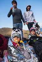 A group of Iraqi refugees from Mosul rest on the north coast of Lesbos after having completed the dangerous boat journey from Turkey. The children, from left to right, are Husam (age 2), Sara (age 4), and Omar (age 9)