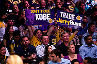 "30 October 2007: Los Angeles Lakers fans hold up signs that say, ""Don't Trade Kobe, "" and, ""Trade Jerry Buss"" while the Lakers play the Houston Rockets during the Rockets 95-93 victory over the Lakers at the STAPLES Center in Los Angeles, CA."