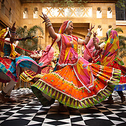 Rajasthani dancers entertain the guests during a mehendi ceremony of an Indian wedding at the Leela palace in Udaipur
