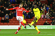 Burton Albion's Hope Akpan and Barnsley's Liam Lindsay during the EFL Sky Bet Championship match between Barnsley and Burton Albion at Oakwell, Barnsley, England on 20 February 2018. Picture by John Potts.