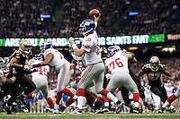 28 November 2011: Quarterback (10) Eli Manning of the New York Giants passes the ball against the New Orleans Saints during the first half of the Saints 49-24 victory over the Giants at the Mercedes-Benz Superdome in New Orleans, LA.