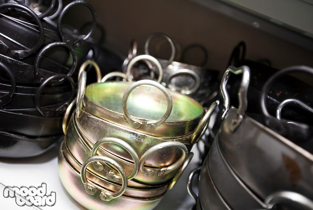 Stacked kitchen utensils in store