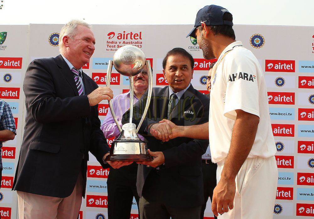 Allan Border and Sunil Gavaskar present the Border Gavaskar trophy to MS Dhoni of India during day 3 of the 4th Test Match between India and Australia held at the Feroz Shah Kotla stadium in Delhi on the 24th March 2013..Photo by Ron Gaunt/BCCI/SPORTZPICS ..Use of this image is subject to the terms and conditions as outlined by the BCCI. These terms can be found by following this link:..http://www.sportzpics.co.za/image/I0000SoRagM2cIEc
