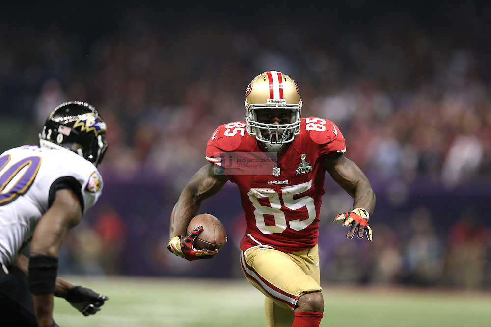Vernon Davis (85) of the San Francisco 49ers catches a pass against the Baltimore Ravens during the NFL Super Bowl XLVII football game in New Orleans on Feb. 3, 2013. The Ravens won the game, 34-31.  (Photo by Jed Jacobsohn)