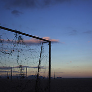 Football posts with torn netting on Copacabana beach,  Rio de Janeiro,  Brazil, during sunset on the 5th July 2010. Photo Tim Clayton....