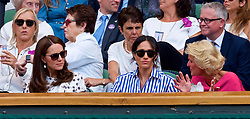 LONDON, ENGLAND - Saturday, July 14, 2018: Royal WAGS Catherine Middleton (Duchess of Cambridge married to William Windor) (left) and Rachel Meghan Markle (Duchess of Sussex married to Harry Windsor) (right) in the Royal Box during the Ladies' Singles Final match on day twelve of the Wimbledon Lawn Tennis Championships at the All England Lawn Tennis and Croquet Club. (Pic by Kirsten Holst/Propaganda)