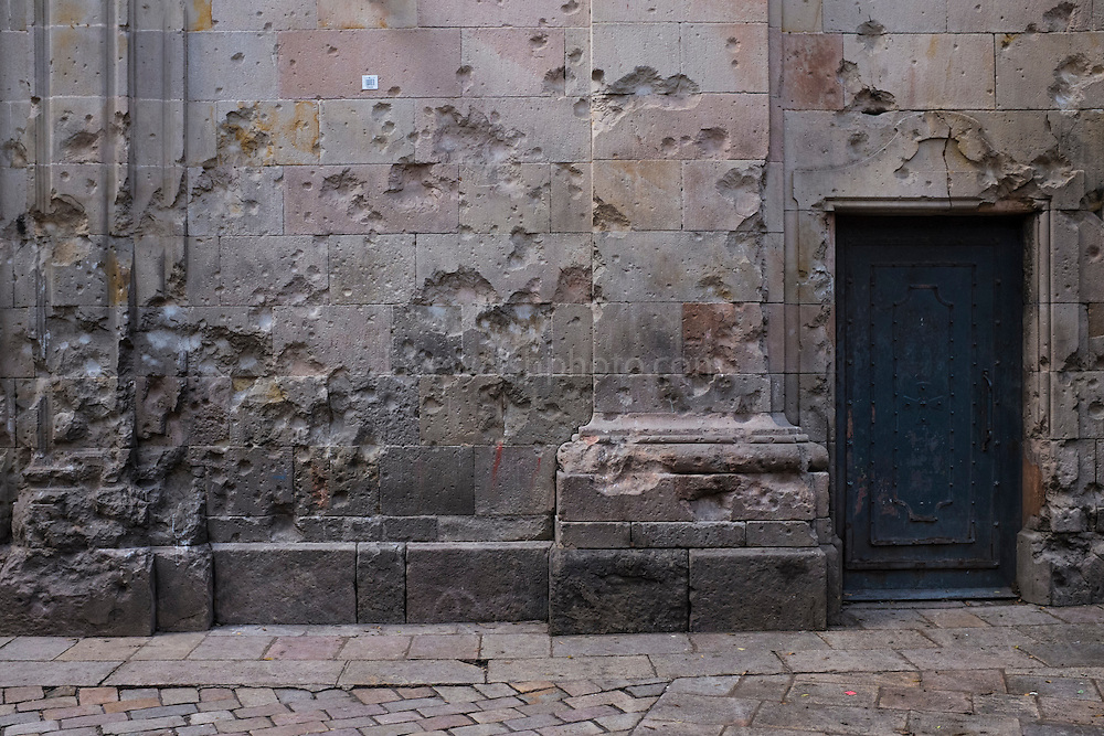 Signs of the Spanish Civil War - shrapnel marks on the Plaça Sant Felip Neri, Barcelona. 42 people were killed here on January 30, 1938, when facist aircraft dropped bombs on Barcelona. Many of the dead were children.