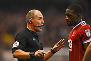 Referee Scott Duncan has words with Nottingham Forest defender Tendayi Darikwa (27) during the EFL Sky Bet Championship match between Nottingham Forest and Fulham at the City Ground, Nottingham, England on 26 September 2017. Photo by Jon Hobley.