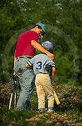 Father encourages 12 year old son at baseball