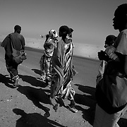 Somalis walk along the highway from Kharaz refugee camp to Aden. The journey on foot will take days.