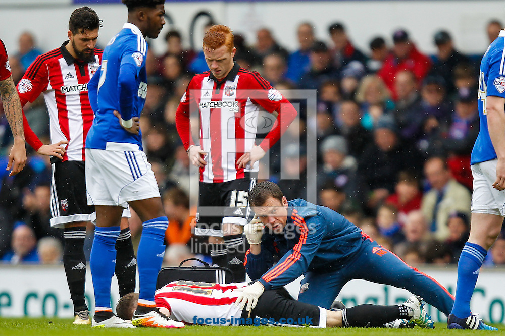 The injured Alan Judge of Brentford is tended to by Brentford Head of Medical Neil Grieg during the Sky Bet Championship match between Ipswich Town and Brentford at Portman Road, Ipswich<br /> Picture by Mark D Fuller/Focus Images Ltd +44 7774 216216<br /> 09/04/2016