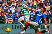 James Tavernier (C) of Rangers FC challenges Jonny Hayes of Celtic FC during the Ladbrokes Scottish Premiership match between Rangers and Celtic at Ibrox, Glasgow, Scotland on 12 May 2019.