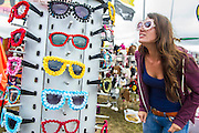 A strange assortment of sunglasses and hats lure festival goers in the lull of the morning. The 2013 Glastonbury Festival, Worthy Farm, Glastonbury. 28 June 2013.  © Guy Bell, guy@gbphotos.com, all rights reserved