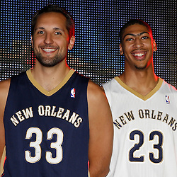 Aug 1, 2013; Metairie, LA, USA; New Orleans Pelicans players Ryan Anderson (33) and Anthony Davis (23) during a uniform unveiling at the team practice facility. Mandatory Credit: Derick E. Hingle-USA TODAY Sports