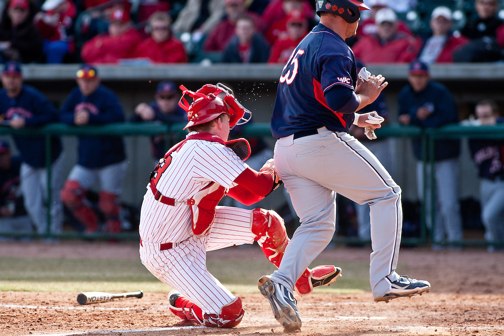March 11, 2011: Nebraska's Cory Burleson #13 tags Fresno State's Jordan Ribera #25 at home during the fifth inning at Haymarket Park in Lincoln, Nebraska. Fresno State defeated Nebraska 8 to 5 in the first game of the three game series.