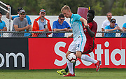 Slovenia midfielder Nejc Klasnija (14) and Portugal forward Herculano Nabian (9) vie for possession of the ball during a CONCACAF boys under-15 championship soccer game, Sunday, August 11, 2019, in Bradenton, Fla. Portugal defeated Slovenia in the final in 2-0. (Kim Hukari/Image of Sport)