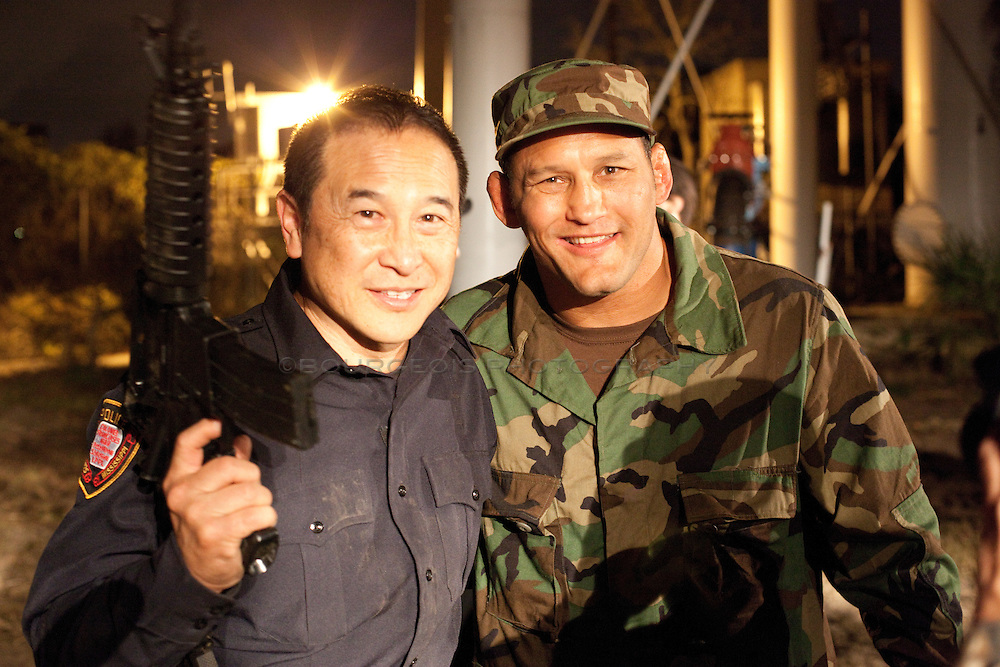 James Lew and Dan Henderson on set of Blunt Force, directed by Daniel Zirilli, executive producer Saye Yabandeh