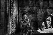 Nepal. Woman at entrance to her home.