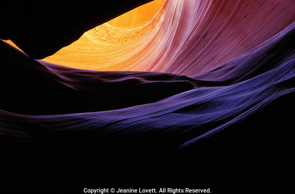 Color changes on the red rock of the slot canon from the heat of the sun to the cold of the bottom of the slot canyon.
