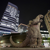 Asia, Tokyo, Japan, Small statue of Godzilla in Hibiya District at night