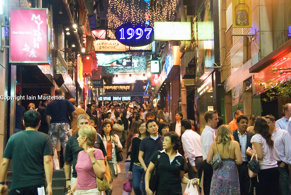 Busy street at night in Lan Kwai Fong entertainment district of Hong Kong china
