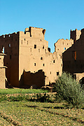 KELAAT M'GOUNA, MOROCCO - 14TH MAY 2016 - Derelict Moroccan kasbah architecture nearby to the rose fields inside the Dades Valley - also known as the 'Valley of Roses,' Kelaat M'Gouna, Southern Morocco.