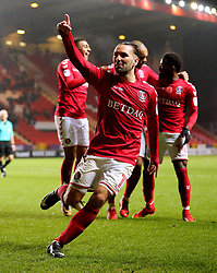 Charlton Athletics Ricky Holmes celebrates after Milton Keynes Dons Scott Golbourne scored an own goal during the Sky Bet League One match at The Valley, Charlton.
