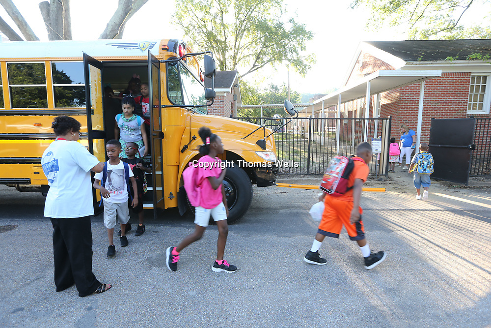 Students unload off the school bus for their first day of the new school year at Lawhon Elementary School.
