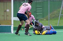 Teddington's Darren Marchant saves a Southgate penalty corner. Southgate v Teddington - Men's Hockey League East Conference, Trent Park, London, UK on 21 February 2016. Photo: Simon Parker