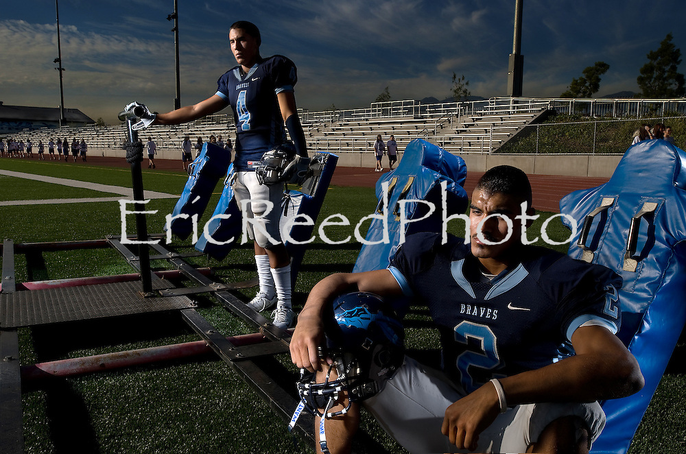 Baldwin Park High School Football Team members: Wide Receiver,Christian Lazaro, left, and Quarterback Manny Salcedo at Braves Field, Nov. 9, 2009. **CAPTION MUST READ -PHOTO ILLUSTRATION BY** (SGVN/Staff Photo by Eric Reed/SPORTS)