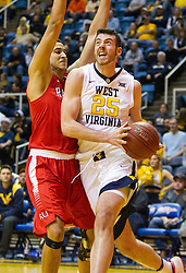 Dec 20, 2016; Morgantown, WV, USA; West Virginia Mountaineers forward Maciej Bender (25) drives baseline during the second half against the Radford Highlanders at WVU Coliseum. Mandatory Credit: Ben Queen-USA TODAY Sports