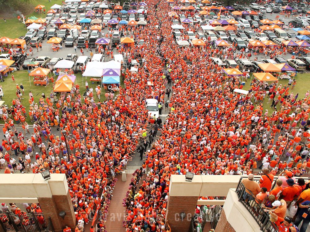 Players are greeted by fans outside Death Valley during Tiger Walk before the start of the Georgia game on Saturday, Aug. 31, 2013. (Travis Bell/Sideline Carolina)