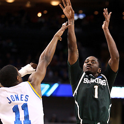 Mar 17, 2011; Tampa, FL, USA; Michigan State Spartans guard Kalin Lucas (1) shoots over UCLA Bruins guard Lazeric Jones (11) during the first half of the second round of the 2011 NCAA men's basketball tournament at the St. Pete Times Forum.  Mandatory Credit: Derick E. Hingle