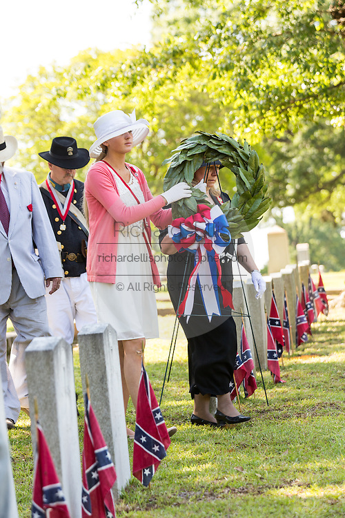 Members of the United Daughters of the Confederacy place a wreath during a service at Elmwood Cemetery to mark Confederate Memorial Day May 2, 2015 in Columbia, SC. Confederate Memorial Day is a official state holiday in South Carolina and honors those that served during the Civil War.
