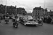 Cavalcade of President John F. Kennedy makes its way through Dublin, cheered on by thousands of spectators.