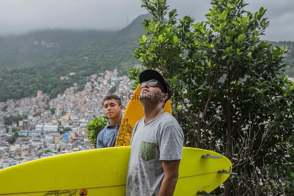 """Bocão"" and his son Ricardo, on the top of Rocinha's slum"