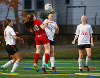 Berlin's Kaylee Amato and Laconia's MacKenzie Howe go up for the ball during NHIAA Division III Soccer on Tuesday evening.  (Karen Bobotas/for the Laconia Daily Sun)
