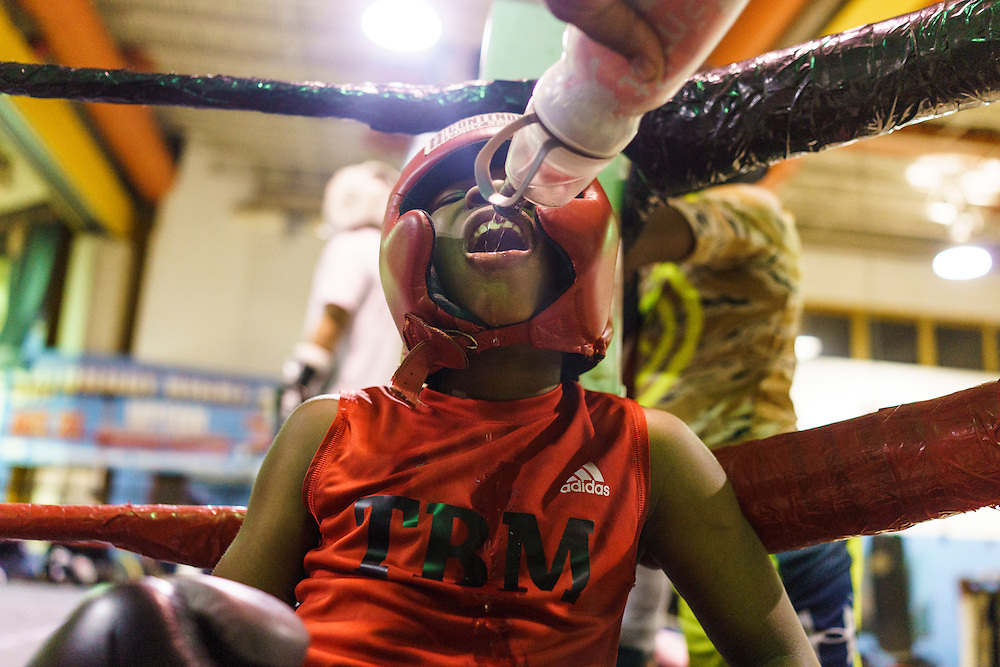 Baltimore, Maryland - January 26, 2017: Boxer Nieem &quot;The Brutal Machine&quot; Somerville, 10, takes a water break after sparring at the Upton Boxing Club in West Baltimore Thursday January 26, 2017.<br /> <br /> Upton Boxing Club is where Coach Calvin Ford, the inspiration for character Dennis &quot;Cutty&quot; Wise from &quot;The Wire,&quot; coaches. It's also the gym where Gervonta Davis, the current IBF junior lightweight champion, trains. Davis is undefeated (17-0) with 16 KOs. He also coaches dozens of amateurs and a few other professionals.<br /> <br /> CREDIT: Matt Roth for The New York Times<br /> Assignment ID: 30201545A