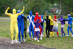 © licensed to London News Pictures. Tamworth/Staffordshire, UK  07/05/2011. Morphsuit challenge to break the Guiness World Record at Drayton Manor Park, Tamworth, Staffs. Pictured, Morphs do a conga. Please see special instructions for usage rates. Photo credit should read Dave Warren/LNP