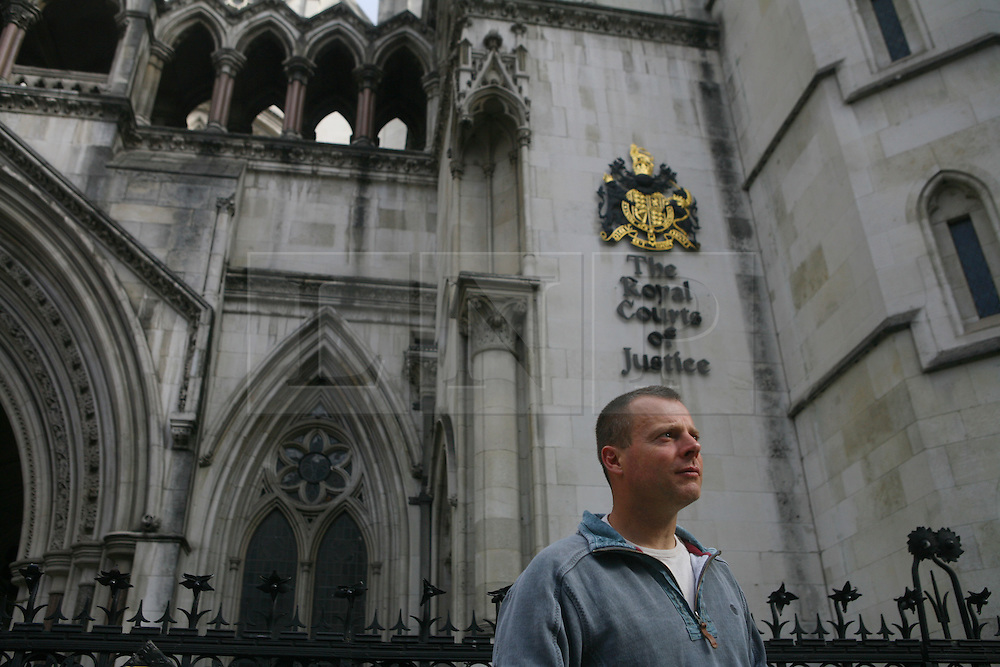 © Licensed to London News Pictures 01/05/2013.Fisherman Adrian Leicester stands outside the High Court who, along with a group of other fishermen from different parts of Britain supported by Greenpeace, have arrived to hear the start of a landmark legal case regarding who controls Britain's fishing quota. Large companies control 95% of the quota, in contrast to small scale fishermen who have access to 4% of fishing rights. Large companies are bringing the government to court over its decision to re-locate a small surplus of the fishing quota back to the small scale fishing, which Greenpeace supports as it is more sustainable..London, UK.Photo: Anna Branthwaite/LNP
