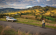 Couple enjoying the view and a coffee in The Barrington Tops, the Hunter Valley, NSW, Australia.