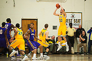 Catamounts forward Ethan O'Day (32) takes a shot during the men's basketball game between the Albany Great Danes and the Vermont Catamounts at Patrick Gym on Wednesday night January 28, 2015 in Burlington, Vermont. (BRIAN JENKINS, for the Free Press)