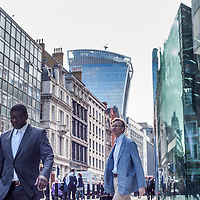 London ,UK - 18 August 2014: businessman goes to work during the morning rush hour in The City of London